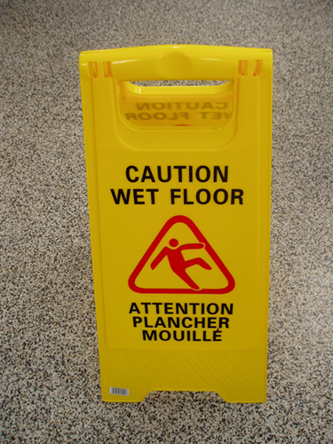 "Picture of Double sided ""Caution wet floor"" sign 24''"